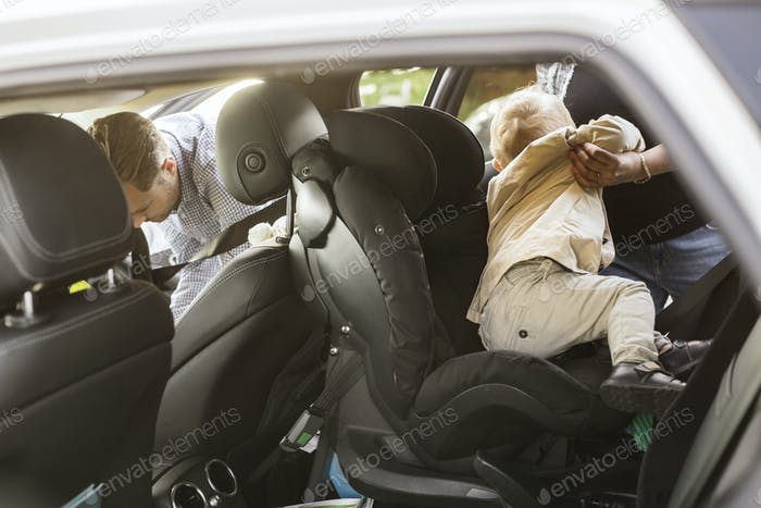 Mother taking out son (18-23 months) out of car