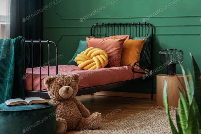 Big, brown teddy bear and an open book