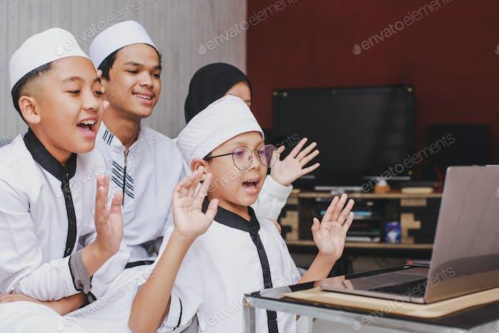 Muslim family doing video conference at Eid Mubarak