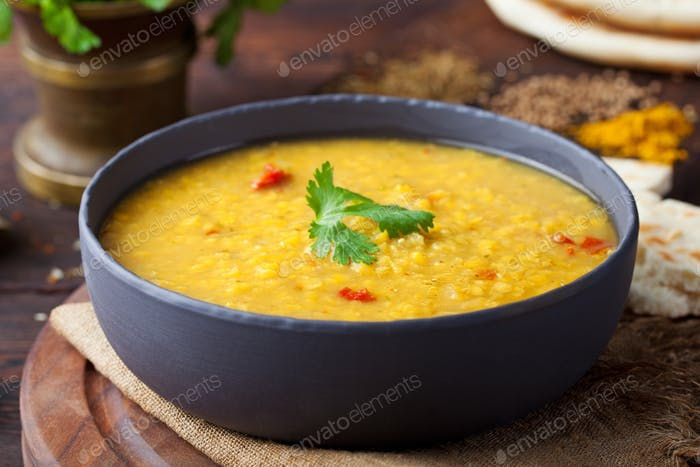 Red lentil Indian soup with flat bread Masoor dal