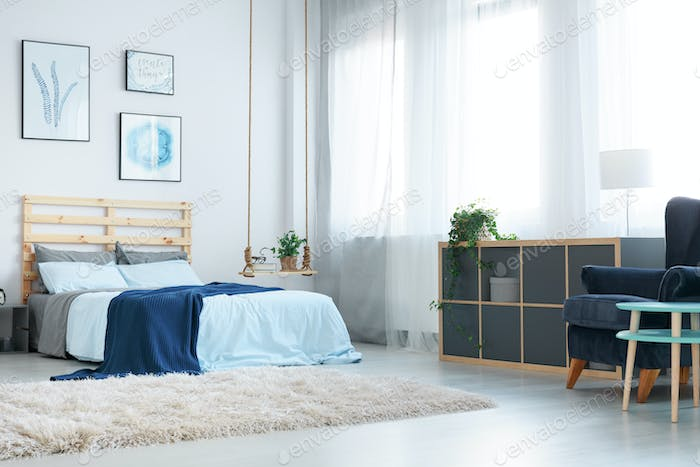Bedroom with decorative wall posters