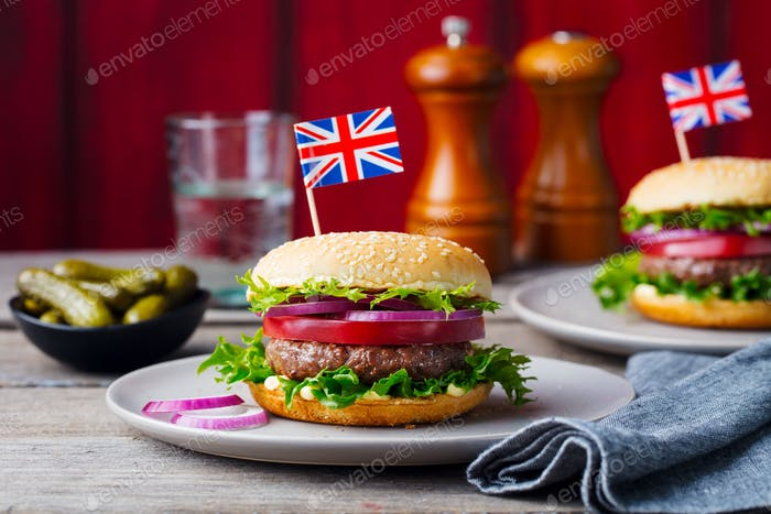 Burger with British Flag on Top. Wooden Background.