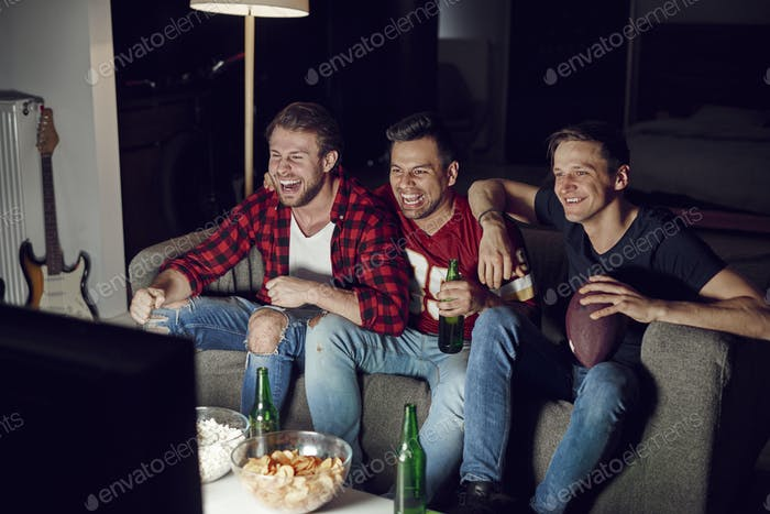 Men watching american football competition