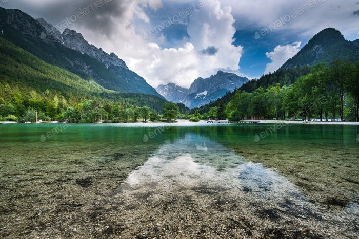 Clear water and Julian Alps reflection in Lake Jasna, Slovenia