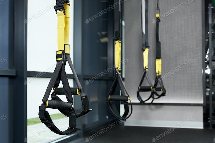 Black and yellow TRX in gym.