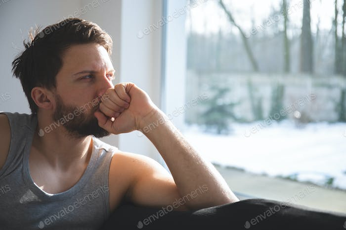 Thoughtful man at home