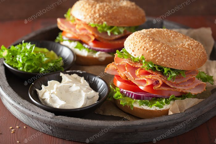ham sandwich on bagel with cream cheese tomato onion