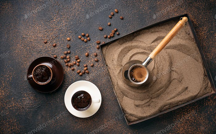 Traditional turkish coffee prepared on hot sand