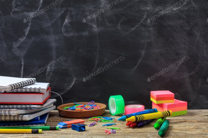 School supplies on a wooden desk