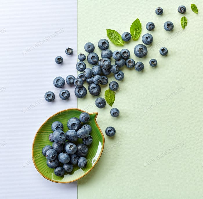 blueberries on colorful paper background