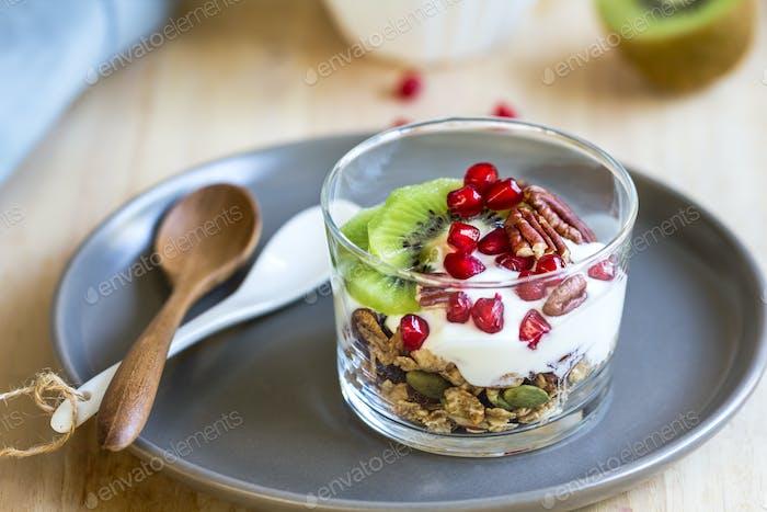 Granola with Greek yogurt ,Kiwi and Pomegranate