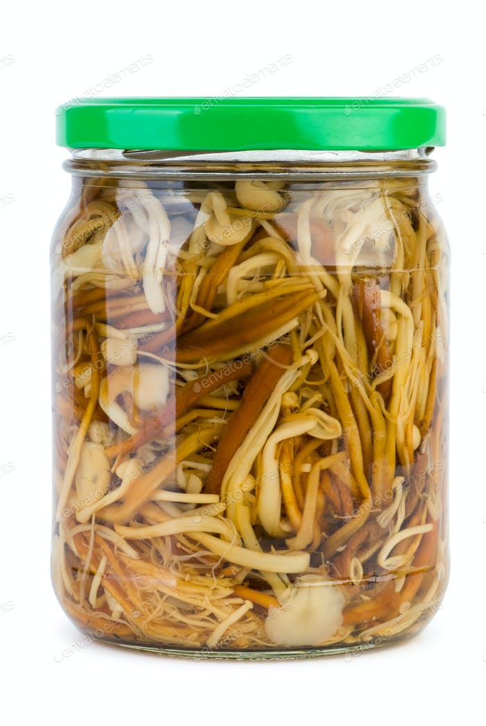 Glass jar with marinated enokitake mushrooms