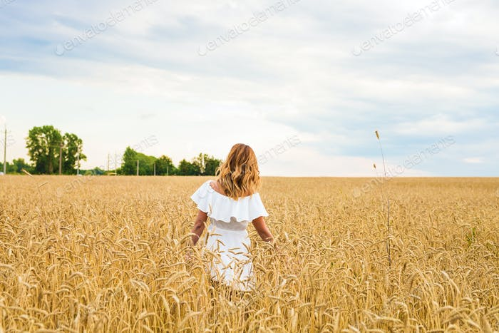 Young woman walking in the field