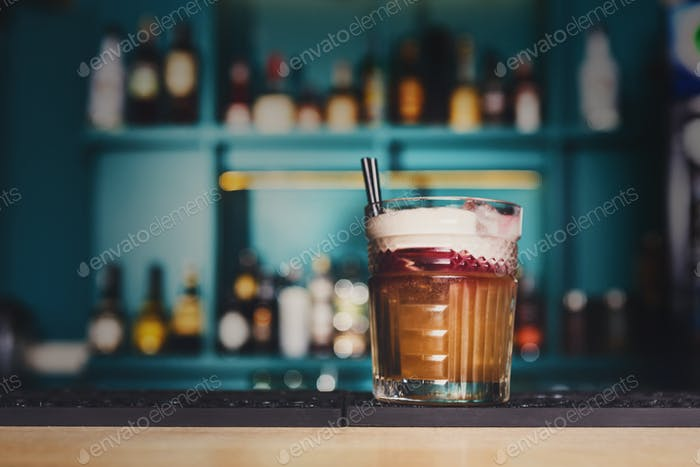 Creative cocktail in night club bar background