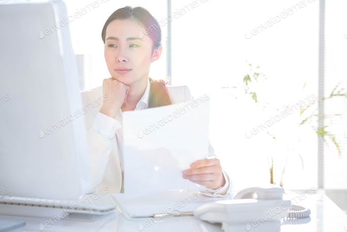 Smiling businesswoman using computer at the desk in work