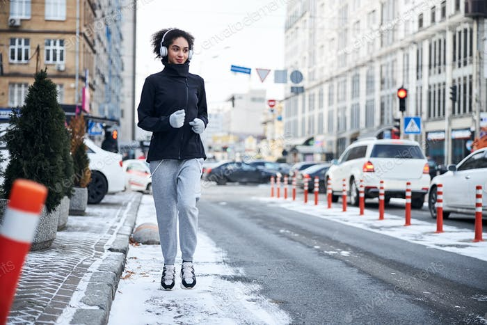 Woman going for a run on a roadside