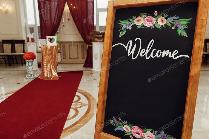 rustic decor with wooden box and herbs, wedding arch and aisle