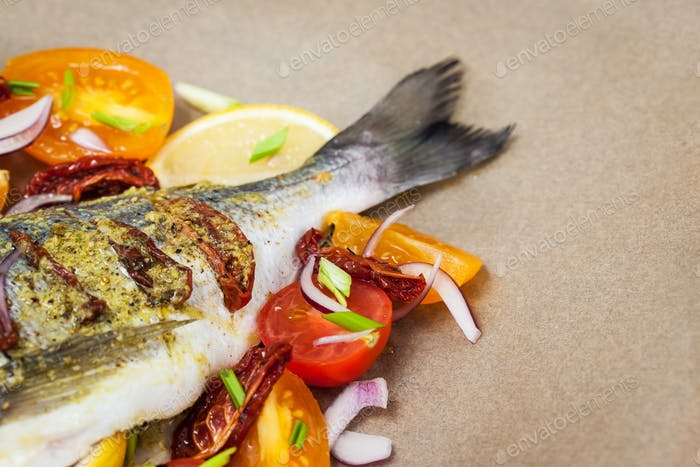 Raw whole sea bream fish and vegetables ingredients