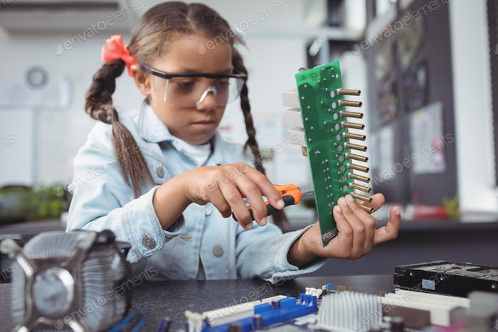 Concentrated elementary girl assembling circuit board