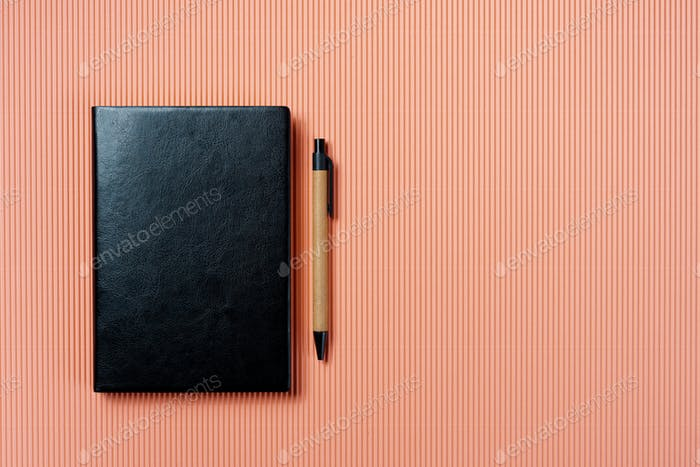 Leather notebook cover on a pale pink background