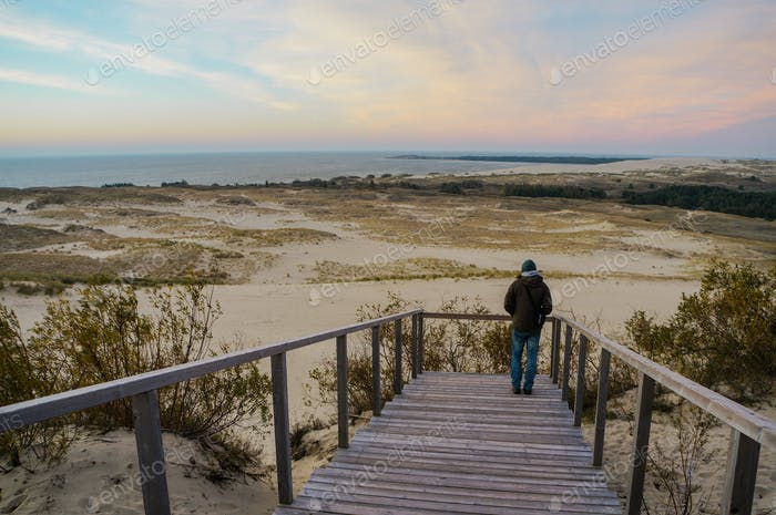 Person on Wooden Pier on Sandy Beach, Poland, Curonian Spit