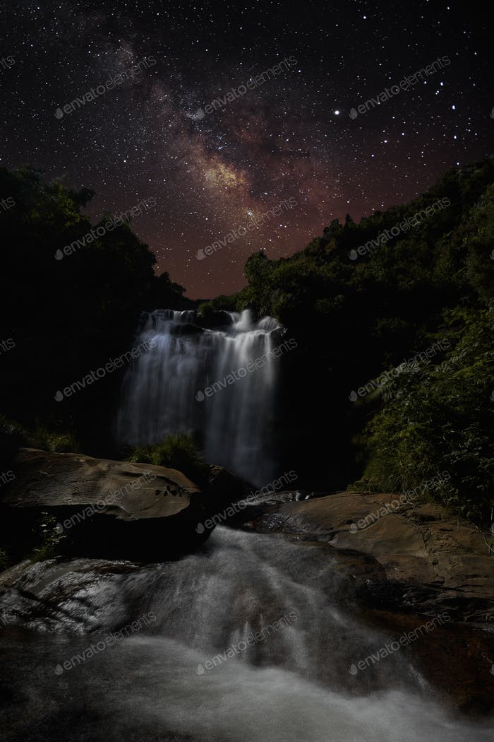 The Milky Way over a Waterfall illuminated by the Moonlight