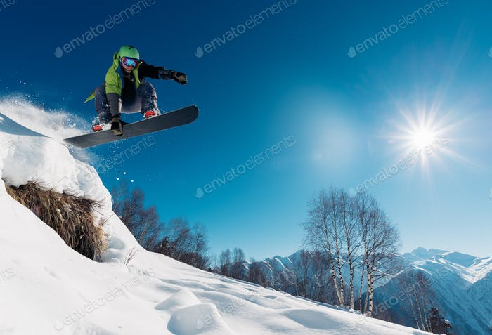 snowboarder is jumping with snowboard