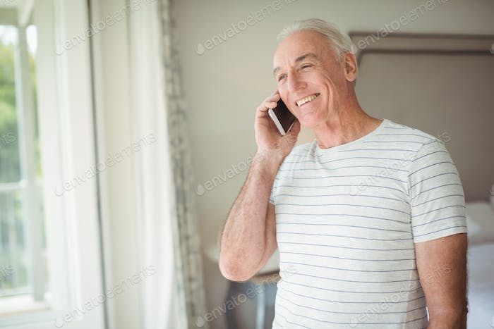 Happy senior man talking on mobile phone
