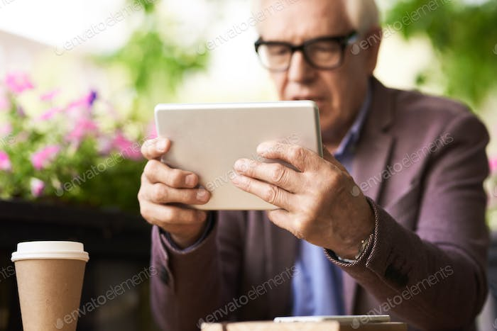 Grandpa Learning to use Digital Tablet