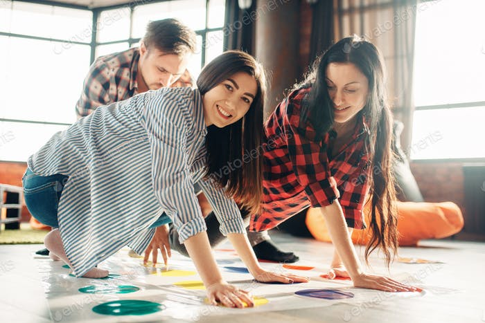 Group of students playing twister game