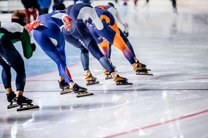 Group of Men Speed Skating on Ice Arena