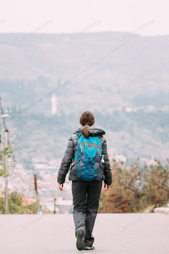 Tbilisi, Georgia. Young Woman Walking Near Mountains In Autumn D