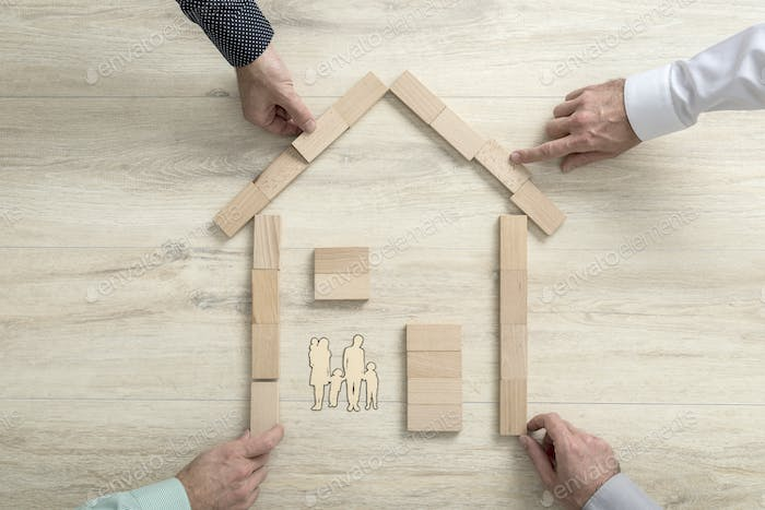 People making the shape of a residential house for a family