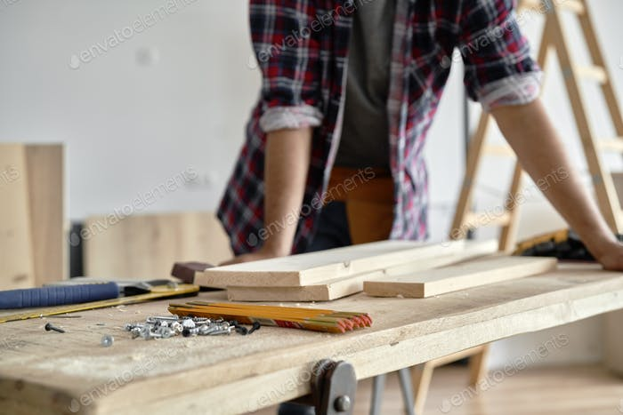 Carpenter standing at the workbench