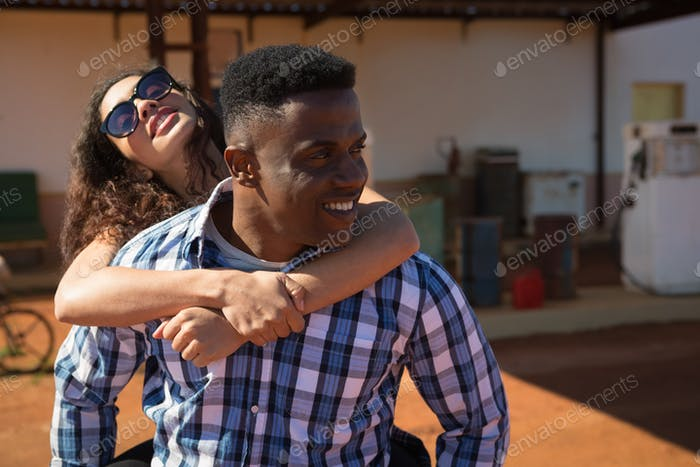 Man giving a piggyback ride to woman