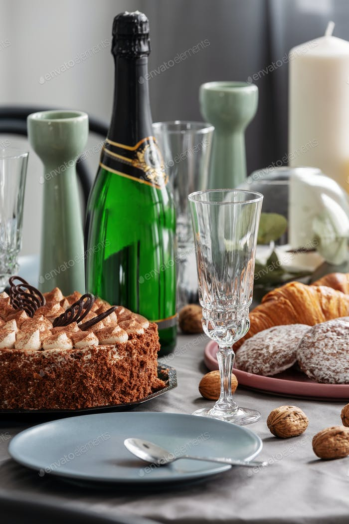 Closeup of dining table set for birthday party with champagne