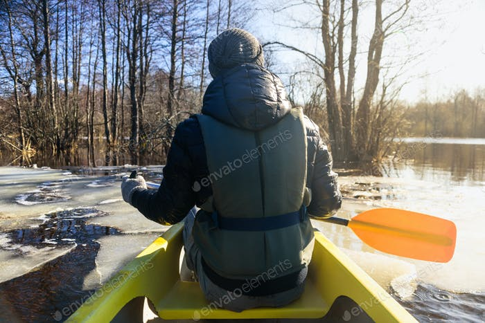 Man in canoe with paddle