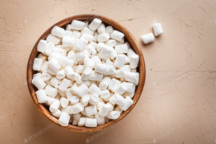 Marshmallows in a wooden bowl