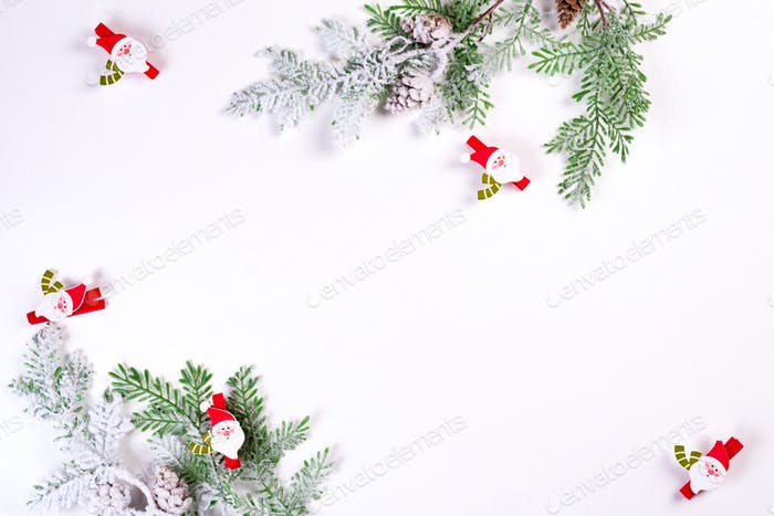 Christmas background. Christmas fir tree branch with Santa on white background. Copy space, top view