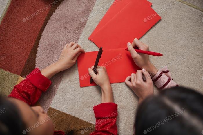 Children Decorating Red Envelopes