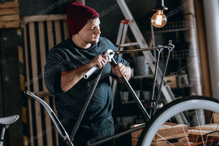 Worker repairing bike