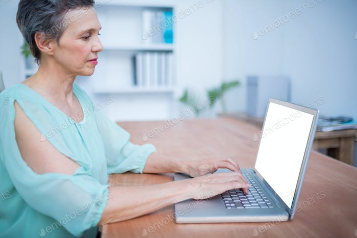 Portrait of an attentive businesswoman working on laptop