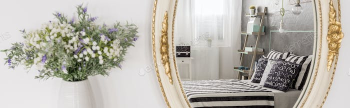 Gray bedroom with golden mirror