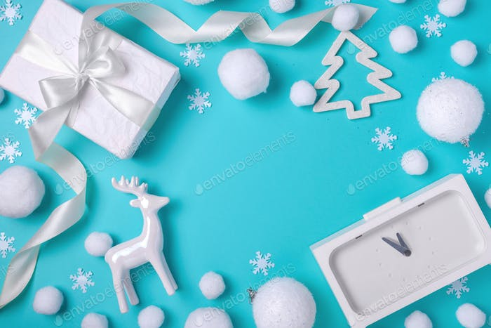 Stylish Christmas composition with white objects: balls, clock, deer, gift box