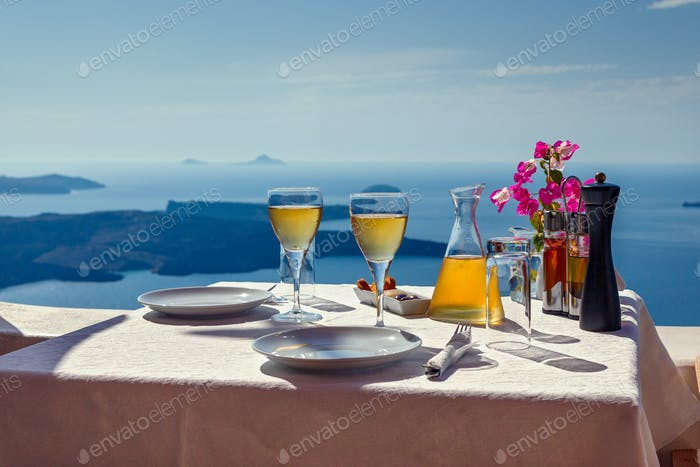 Table and two glasses of wine  the island of Santorin