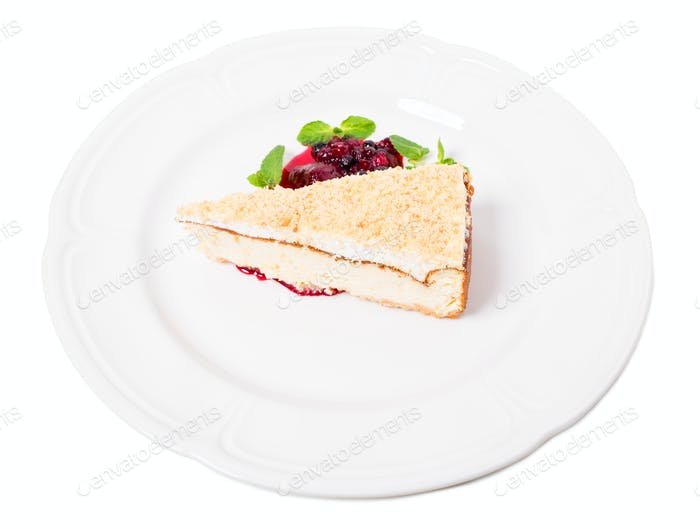 Traditional cheesecake with berry jam.