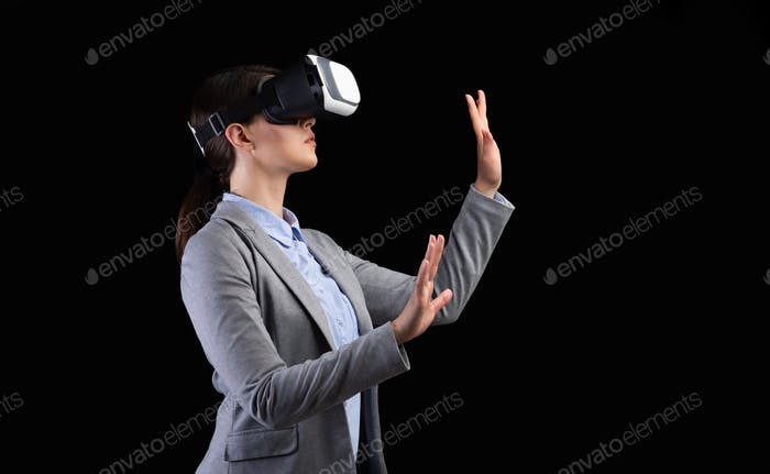 Businesswoman Using VR Headset On Black Background