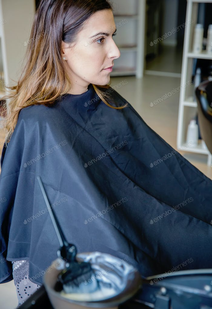 Young woman ready for a  hair color change