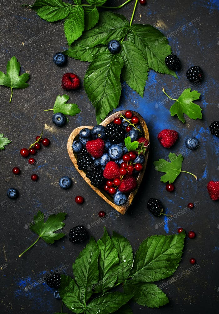Selection of summer berries in heart shape bowl