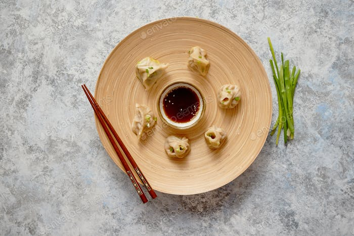 Delicious chinese dumplings served on wooden plate